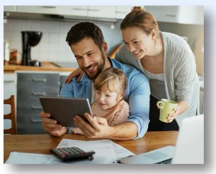 Mom, Dad and child on tablet
