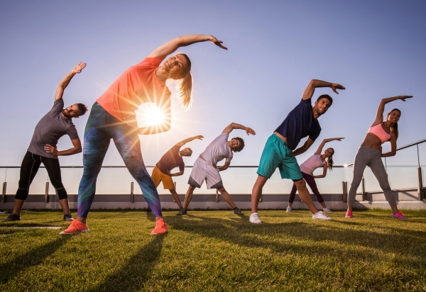 outdoor workout class at sunset