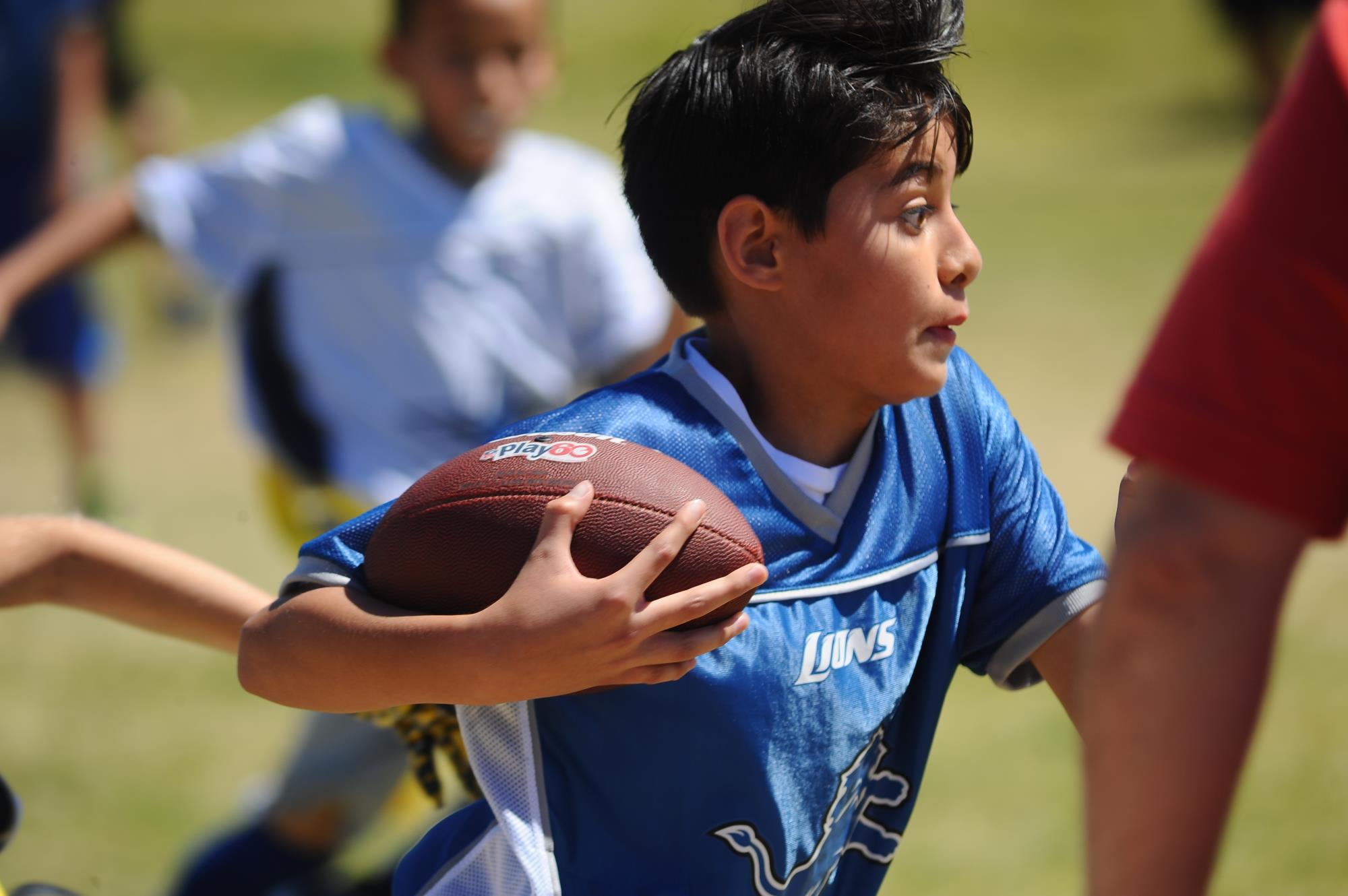 Flag Football kid running with ball