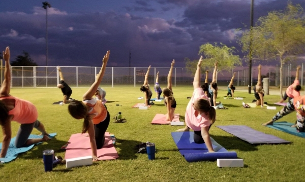 Students at an Outdoor Yoga Class