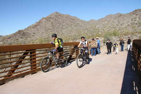 bike riders on skyline park bridge