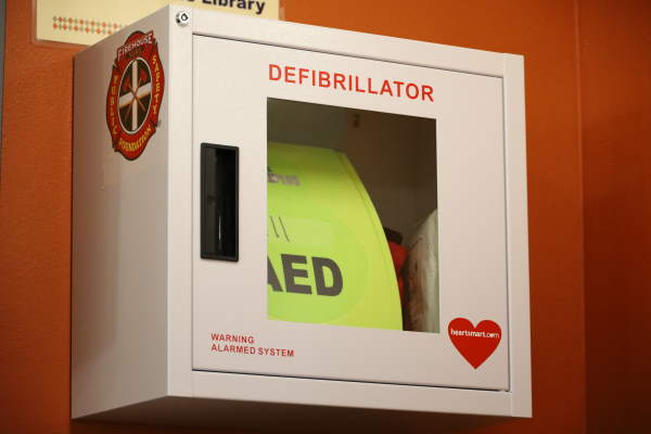 Automated External Defibrillator hanging on wall