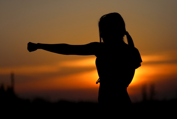 lady doing karate at sunset