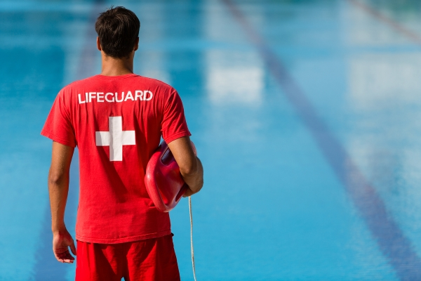 back of lifeguard overlooking a pool