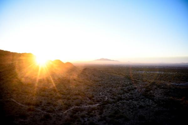 Sun rising over mountain