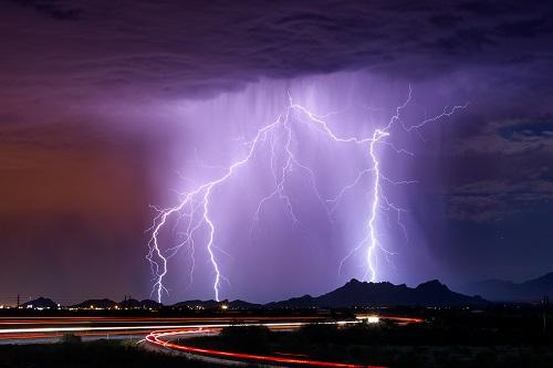 Lightning flashes over the desert. www.istockphoto.com/portfolio/mdesigner125
